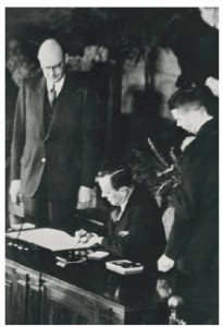 Then-external affairs minister Lester B. Pearson signs the NATO treaty for Canada.