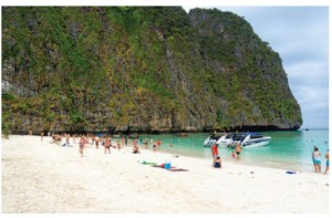 Phi Phi Islands, Thailand, feature limestone cliffs surrounding secluded beaches and brilliant turquoise water. (Photo: © Toxawww | Dreamstime.com )