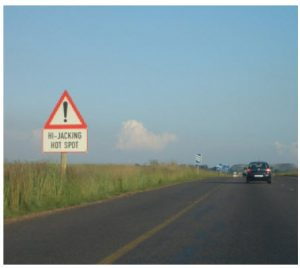 Certain places in South Africa, such as this one on the N4 near Witbank, feature signs warning of vehicle hijackings. (Photo: Zakysant )