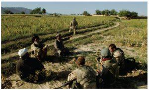 NATO soldiers speak to tribal elders in Afghanistan. (Photo: US military)