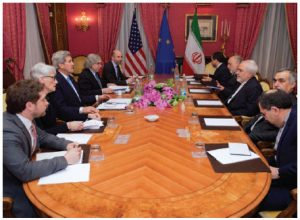 U.S. Secretary of State John Kerry, with State Department officials and others, sits across from Iranian Foreign Minister Mohammad Javad Zarif and advisers in Lausanne, Switzerland, before resuming negotiations about the future of Iran's nuclear program. (Photo: State Department)