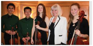Norwegian Ambassador Mona Elizabeth Brother hosted a concert and dinner for Friends of the NAC Orchestra's Music to Dine For event at her residence. From left: Emerald String Quartet musicians Ethan Balakrishnan (viola), Jerry Wang (violin), Alisa Klebanov (violin), Ambassador Brother and Emma Grant-Zypchen (cello). (Photo: Ulle Baum)