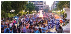 Greeks in Athens celebrate the results of the July 5 referendum on austerity measures proposed by the EU and IMF. (Photo: © Conejota   Dreamstime.com)