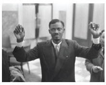 Patrice Lumumba, the Congo's first democratically elected leader, raises his hands, injured by shackles, after being released from prison. He was later assassinated. (Photo: Nationaal Archief Fotocollectie Anefo)