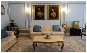 The first reception room is decorated in pale blue and features large portraits of the king and queen of Thailand. (Photo: Dyanne Wilson)