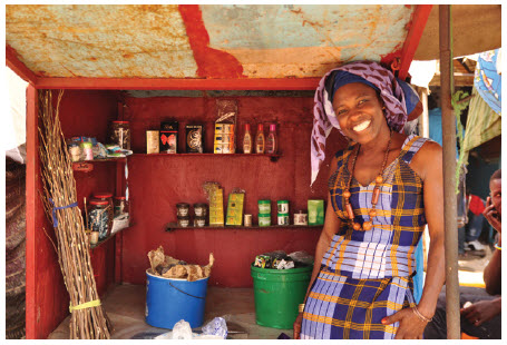 Fatou Kiné Fall left an abusive marriage and turned her life around with entrepreneurial training. Now she is the proud owner of a kiosk that sells cosmetics and toiletries to travellers.