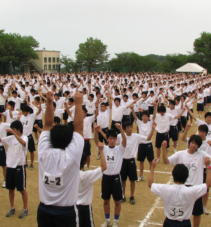 The Japanese government tracks levels of physical activity among its citizens. These students are taking part in a morning exercise routine at their high school in Kobe.