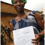A staggering 45 percent of all children under the age of five worldwide do not have a birth certificate, a right that gives them access to education, health care, social and economic opportunities. This woman is holding a substitute birth certificate she received in Côte d'Ivoire.