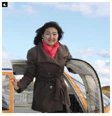 The Ottawa Diplomatic Association hosted its third annual Fly Day, offering flights over Ottawa. Here, Venera Issekenova, assistant to the ambassador of Kazakhstan, steps off the plane. (Photo: Ülle Baum)