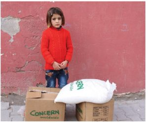 A Syrian girl waits next to relief help at Suruc City, Turkey. (Photo: Caroline Gluck/EU/ECHO)