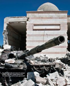 Two destroyed tanks sit in front of a mosque in Azaz, Syria, after a battle between the  Free Syrian Army and the Syrian government. (Photo: Christiaan Triebert)