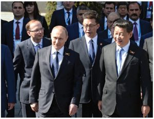 """As Ambassador Alexander Darchiev describes it, Russia has undergone dramatic change, which involved a """"political transition to a strong elected presidency"""" — in the current case, that of President Vladimir Putin, seen here after visiting with Chinese President Xi Jinping. (Photo: Kremlin.ru)"""
