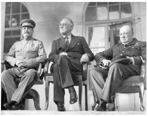 """In addition to celebrating its heroic past, including """"the enormous sacrifices in the war against Nazism,"""" Russia needs to build a more dynamic society on that foundation, Darchiev said. Seen here are Russian president Joseph Stalin, U.S. president Franklin Roosevelt and British prime minister Winston Churchill at the Tehran Conference in 1943. (Photo: US Army)"""