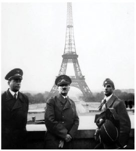 After his army rolled into Paris, Hitler himself showed up and had his picture taken in front of the Eiffel Tower. He is shown here, centre, with architect Albert Speer, left, and Arno Breker, right. (Photo: US National Archives and Records Administration)