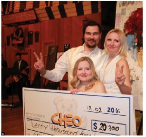 Alpha Art Gallery presented a Valentine Gala fundraiser at the Museum of History in support of the CHEO Foundation. From left, Alpha Gallery director Edith Betkowski, her husband, artist Dominik Solokowski, and daughter, Emilia, 20, who has had several surgeries at CHEO. (Photo: Ülle Baum)