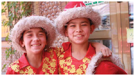 Two members of the Kashgar Acrobatic Group are all smiles after a colourful street performance in the Old City of Kashgar. (Photo: Ülle Baum)