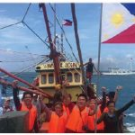 Filipino youth activists from the Kalayaan Atin Ito (Freedom is Ours) group, planted Philippines and United Nations flags on the Scarborough Shoal to mark the Filipino National Day. (Photo: Kalayaan Atin Ito Movement)
