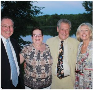 At their residence on June 16, Israeli Ambassador Rafael Barak and his wife, Miriam, both on the left, hosted a reception and talk by Ronald I. Cohen and writer Charlotte Gray for the Sir Winston Churchill Society of Ottawa. Cohen is shown at right, with his wife, Wendy. (Photo: Ülle Baum)