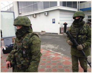 "Unidentified gunmen, known at the time as ""little green men"" were on patrol at Simferopol Airport in Ukraine's Crimea peninsula in February 2014. (Photo: Elizabeth Arrott / VOA)"