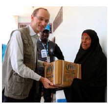 Writer Johannes van der Klaauw distributes kitchen sets and other non-food items to those in need in the besieged city of Taiz.