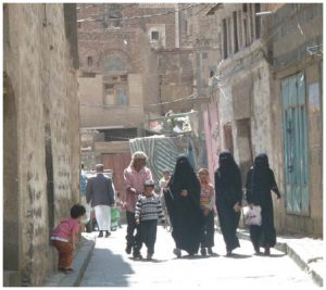 Locals in the old city of Sanaa. Almost all Yemeni women wear a niqab or hijab in public.