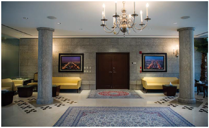 The front foyer of the embassy and residence is grand and imposing, with several pillars and traditional rugs. (Photo: Ashley Fraser)