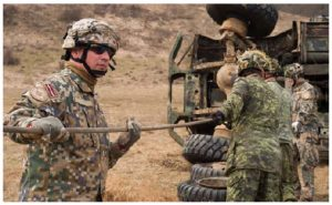 Canadian, American, and Latvian vehicle technicians practise their recovery drills in Latvia. Canada has troops on the ground there as part of an allied operation. (Photo: MCpl Jennifer Kusche, Canadian Forces Combat Camera)