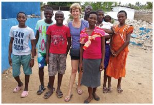 Susan Christie, president Children's Bridge Foundation, in December 2016, with some children at the GOF orphanage in Watamu, Kenya. CBF sponsors their education and Christie visits every year.