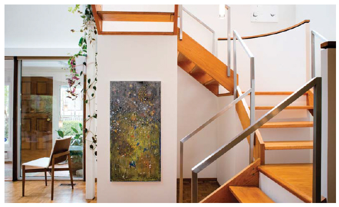 The winding staircase is one of the main floor's more stunning features.  (Photo:  Ashley Fraser)