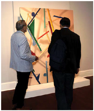 Customers take in a piece of art at Gallery 17/18, which is located at the Czech embassy on Cooper Street. (Photo:  Ashley Fraser)