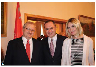 Russian Ambassador Alexander Darchiev (left) hosted a national day reception at the embassy. He's shown with Dimitry Basik, counsellor and chargé d'affaires of Belarus and his wife, Elizaveta. (Photo: Ülle Baum)