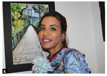 Rafeya Bushenain, second secretary at the UAE embassy, held an exhibit of her photography at Art House Café. She is standing in front of one of her photographs. (Photo: Ülle Baum)