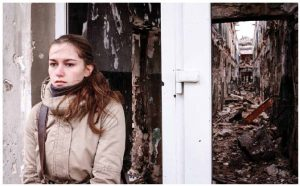 This woman stands in front of a blown-out building in Kurakhove, in Ukraine's Donetsk region. In 2018, the conflict with Russian-backed forces in Eastern Ukraine will drag on, with the Minsk negotiations at an impasse. (Photo: o.V. SVOboda)