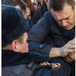 In October, riot police attacked and detained protesters, many of them supporters of lawyer and activist Alexei Navalny, who is shown at the time of his own arrest in March 2017. (Photo: Evgeny Feldman)