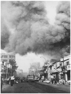 Black smoke covers areas of Saigon while fire trucks rush to the scene of fires set during attacks by the Viet Cong during the Tet holiday period in 1968. (Photo: U.S. government National Archives and Records Administration)