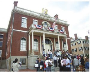 "In 2017, 51 per cent of all international migrants in the world were living in only 10 countries, with the U.S. taking the highest number. Shown here is a ""naturalization ceremony"" on Citizenship Day in Salem, Mass.  (Photo:  Torsten Henning)"