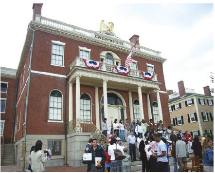 """In 2017, 51 per cent of all international migrants in the world were living in only 10 countries, with the U.S. taking the highest number. Shown here is a """"naturalization ceremony"""" on Citizenship Day in Salem, Mass.  (Photo:  Torsten Henning)"""