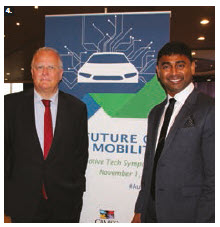 """Peter Fahrenholtz, consul general for the German consulate in Toronto, participated in the first """"Future of Mobility"""" Automotive Tech Symposium at Toronto's Westin Harbour Castle. From left: Fahrenholtz and Dunstan Peter, president and CEO of Trinity Tech. Inc. ( Photo: Ülle Baum )"""