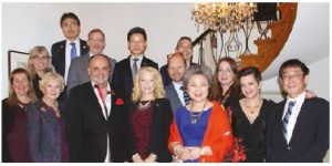 South Korean Ambassador Shin Maeng-ho is happy to share his culture's cuisine for a good cause. He's shown here (fourth from the left, second row) with guests at a dinner in support of the University of Ottawa's Brain and Mind Research Institute. (Photo: Embassy of Korea)