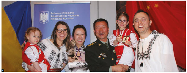 The Ottawa Service Attachés Association organized an international cuisine night at Sala San Marco Conference Centre. From left, Alina Ureche (Romania), Yu Wang (China), her husband, Chinese defence attaché Senior Col. Zhu Haitao and Romanian defence attaché Florin Ureche. Alina and Florin Ureche's two daughters, Ruxandra and Ecaterina, are wearing traditional Romanian costumes. (Photo: Ülle Baum)