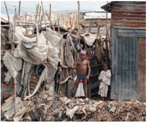Haiti is one of the most densely populated and poorest countries in the Americas. These Haitian children are standing outside the shack that serves as their home. (Photo: UN)