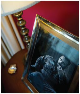 A photo of former Cuban president Fidel Castro sits on a table in the main reception room. (Photo: Ashley Fraser)