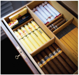 The ambassador's husband has a fine selection of Cuban cigars in his humidor. (Photo: Ashley Fraser)