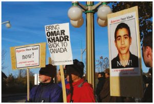 Scott Newark says that the government cutting cheques to child soldiers such as Omar Khadr isn't the answer. Shown here are protesters calling for his return to Canada in 2008. (Photo: AMNESTY INTERNATIONAL)