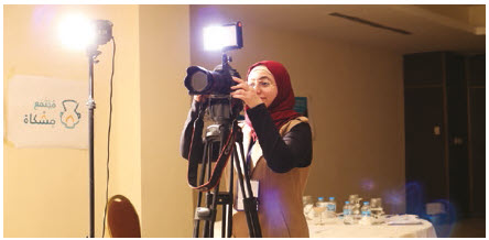 Anwar al Shwabkeh, an artist in residence with the PeaceGeeks Meshkat Community project, works on her film in Jordan.  (Photo: peacegeeks)