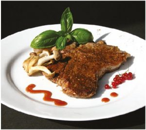 Mushroom-dusted veal chops with Mustard Red Currant Sauce make for a meaty main course. (Photo: Larry Dickenson)