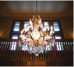 The dramatic foyer features this chandelier and is two storeys tall. (Photo: Ashley Fraser)