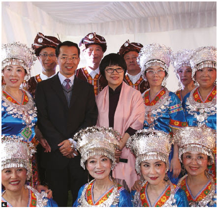 Chinese Ambassador Lu Shaye and his wife, Wang Liwen, (both centre) stand with performers in colourful traditional costumes during the Chinese National day celebrations at the Chinese Embassy. (Photo: Ülle Baum)