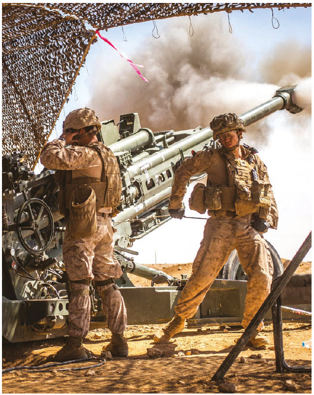 U.S. Marines fire a Howitzer in northern Syria in Operation Inherent Resolve, part of the global coalition to defeat IS (ISIS) in Iraq and Syria. (Photo: Lance Corporal Zachery Laning, U.S. Marine Corps)