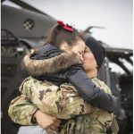 U.S. Army Chief Warrant Officer 3 Austin Randolph hugs his daughter, Elliana, before taking off for a deployment in support of Operation Freedom's Sentinel in Afghanistan. (Photo: U.S. AIR NATIONAL GUARD PHOTO BY MASTER SGT. MATT HECHT)